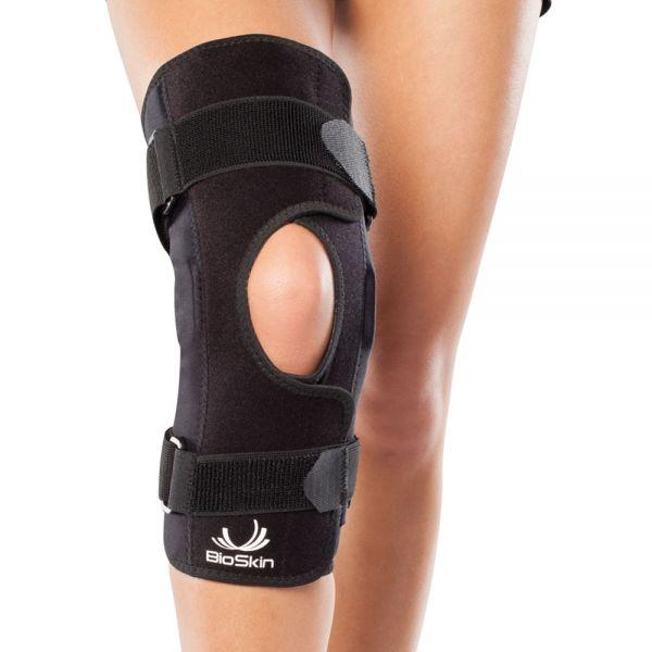 Wraparound hinged knee brace