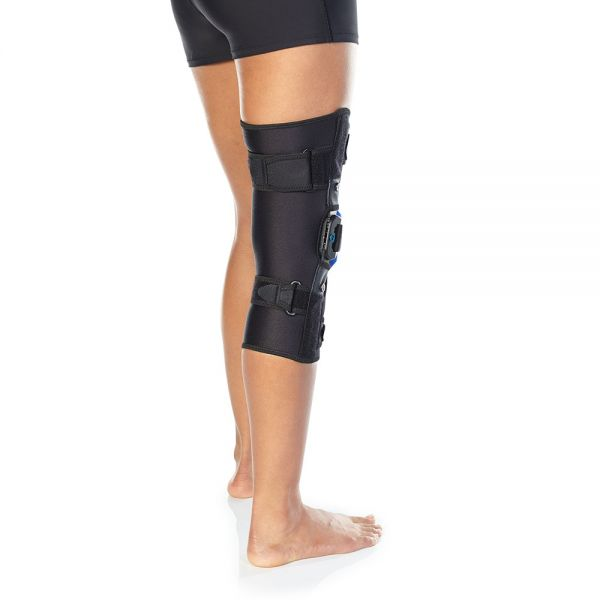 Compression hinged knee brace for patella tracking disorders
