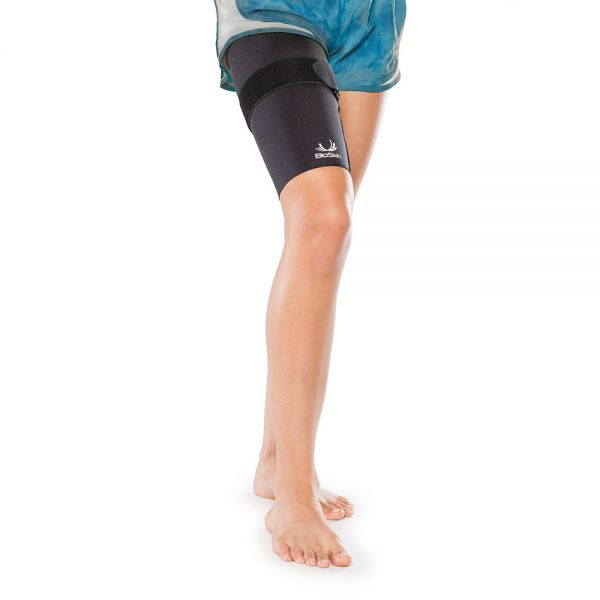 Thigh compression sleeve with cinch strap